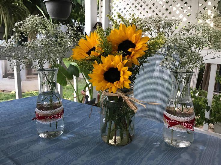 Western party theme centerpieces. #handmade #sunflowers #masonjars #milkbottles