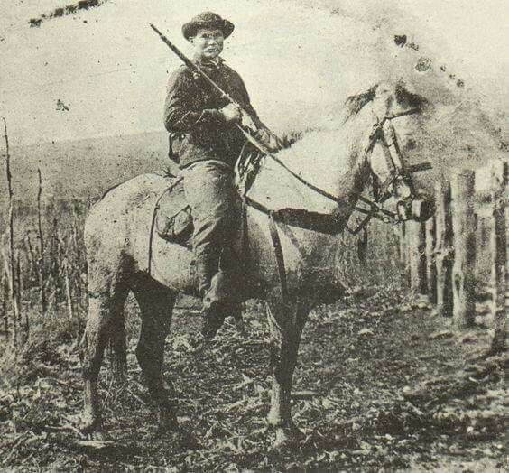 Pvt. John Munson of Attica, Indiana. He served in Company F, 72nd Indiana (Wilder's Brigade), and is pictured here on horseback holding his Spencer repeating rifle.