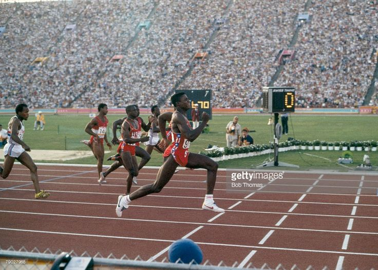 American athlete Carl Lewis finishes first with a time of 9.99 seconds to win the gold medal in the Men's 100 metres sprint event inside the Memorial Coliseum at the 1984 Summer Olympics in Los Angeles, United States on 4th August 1984.