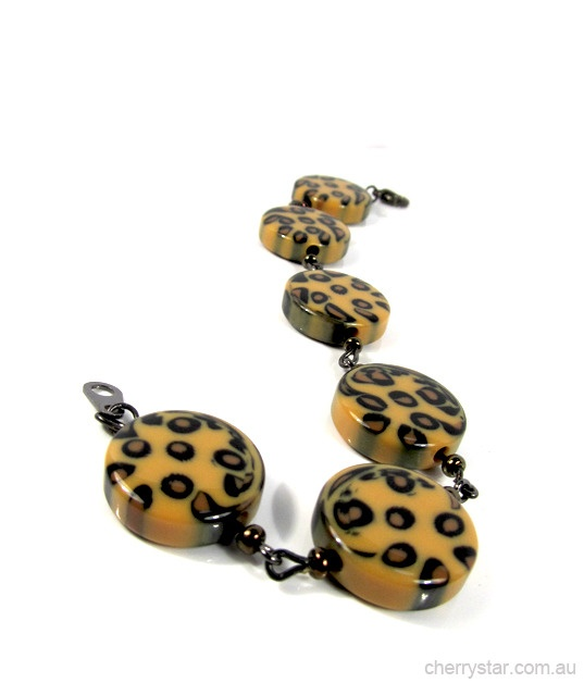 Leopard always looks good, why not add some to your wrist?  Leopard acrylic discs and gunmetal findings make up this cute bracelet with attitude. Let out your wild side!  Hand made by Cherry Star.