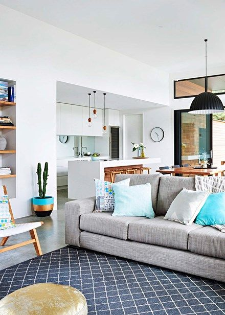 Highlights of teal and turquoise, via a Will & Toots striped plant pot (with a Pippi's Plants cactus) and spotty Marimekko cushions, add calm to the living zone | Home Beautiful Magazine Australia