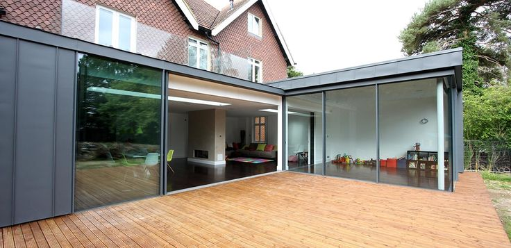 The 25 best ideas about contemporary l shaped kitchens on for Sliding glass doors extension