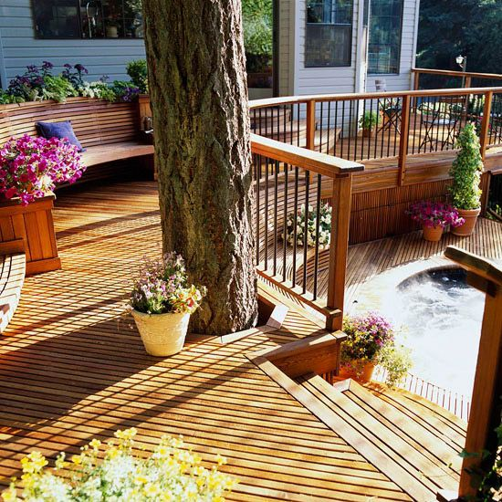 Gorgeous curving 3-level deck with hot tub, lake views, and built-in features.