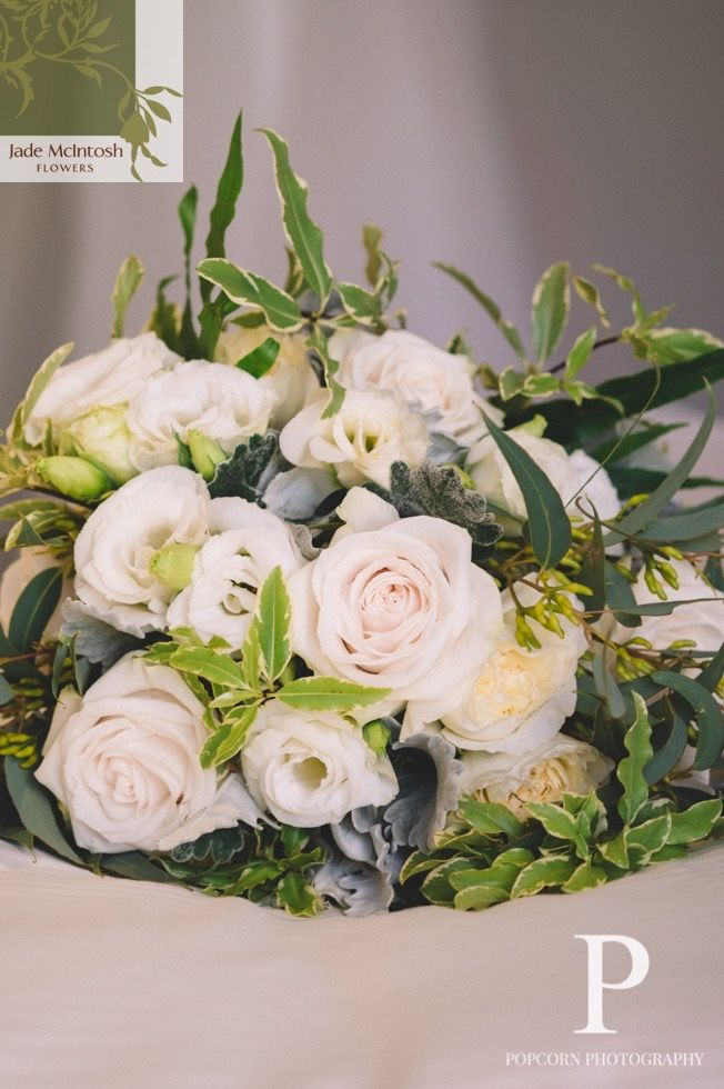 Amy's bouquet of lisianthus and roses in white, cream and the palest of pinks with soft green foliage is a lesson in understated charm. www.jademcintoshflowers.com.au www.popcornphotography.com.au