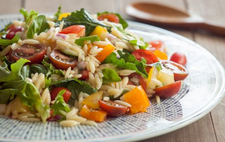A favorite of Whole Foods Market® chefs, you can find a version of this recipe in our stores. This crowd-pleasing salad can be prepared up to a day ahead. Refrigerate the orzo and veggie mixture separately from the dressing and toss them together along with the basil, no more than an hour or two before serving.