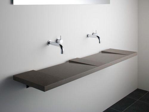 Snygga kranar från Vola. Det är Arne Jacobsen som designat därav det svindyra priset. basins and vola taps