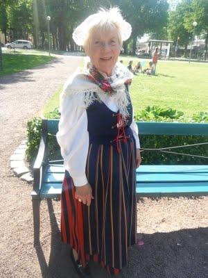 Traditionele dracht op Åland Islands (Finland). Handgemaakt kant en borduurwerk.