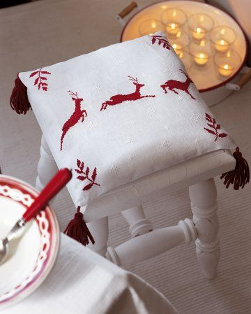 Cushion in white linen, with red deer embroidered cross stitch