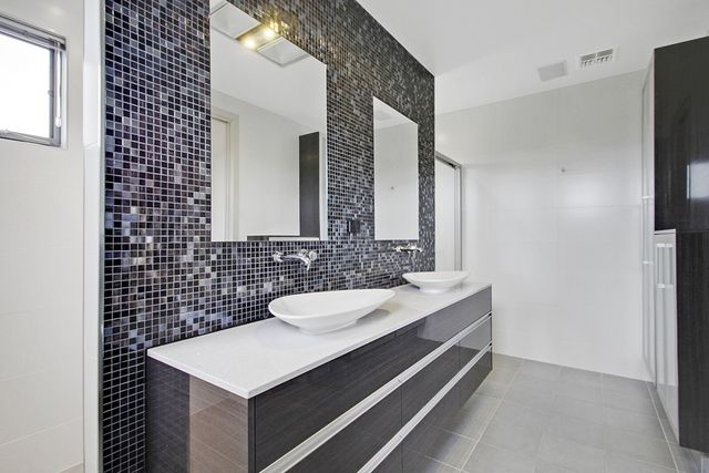 Contrasts of timber, mosaics and light floor and wall - a balanced approach