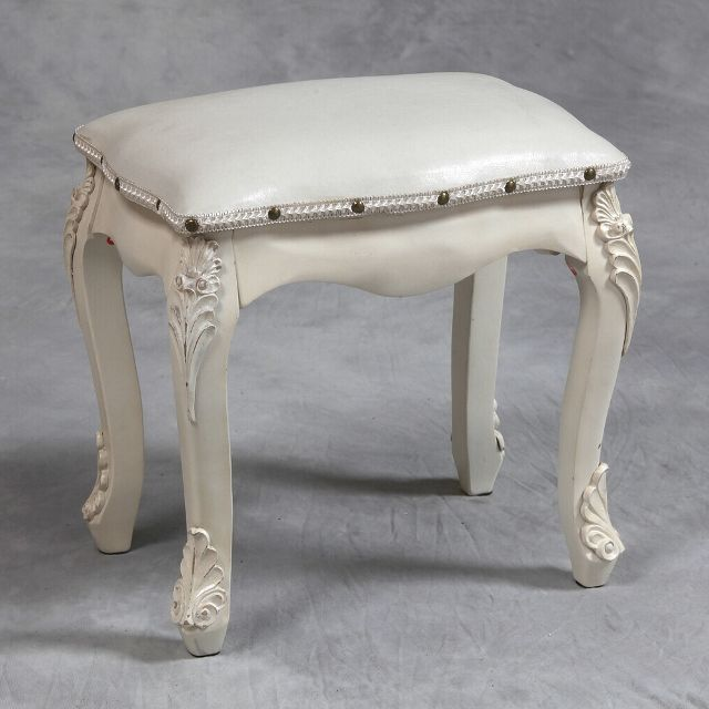 A Chateau antique cream dressing table stool is a stylish antiqued small cream dressing table stool with exquisite carved legs and carved details