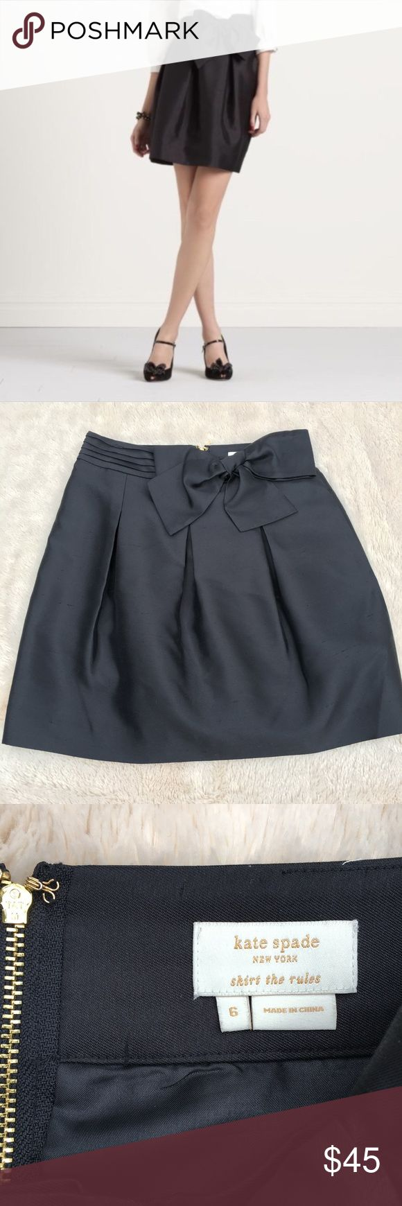 "kate spade NY ""skirt the rules"" silk skirt w/bow kate spade ""skirt the rules"" black silk skirt with pleated detail in front and bow. Has pockets and a gold metal zipper in back! Perfect for the holidays.  The silk has a few snags, looks to me like raw silk, as shown in the closer up photo of the back of the skirt.  The silk has a nice shimmer.  Approx 14.75"" flat waist, 20"" length.  Shell is 100% silk, fully lined, lining is 100% polyester. kate spade Skirts Mini"