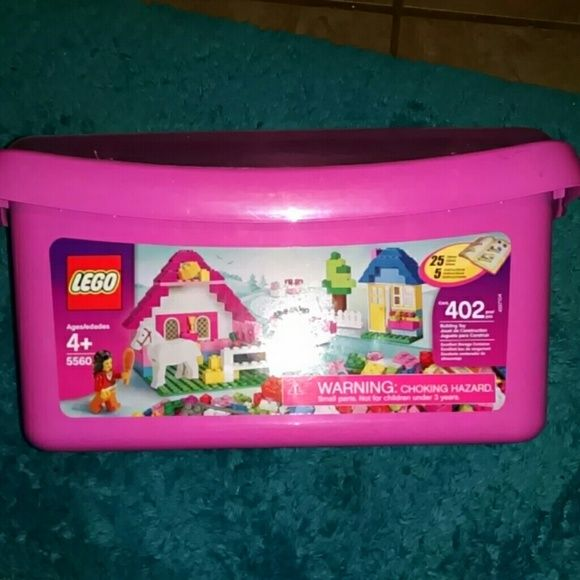 Lego 5560 Horse Pink Brick Set-Sealed Brand NEW Lego 5560 Large Pink Brick Set Sealed Brand NEW  Pink storage case with transparent lid is portable and reusable for years of play!  Contains 402 bricks in 12 colors: three shades of pink, red, yellow, orange, two shades of blue, two shades of green, brown, and gray!  Features a building plate,windows,door,horse and 1 mini figure!  Lots of accessories included too: Horse, brush, cups, pot, golden cup, flowers, fences and wheels! Instruction…
