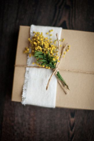 A small bouquet of yellow flowers on burlap and secured by twine make excellent wedding gift wrap.