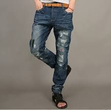 pantalon vaquero roto de hombre año 2000