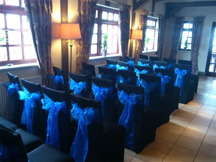 Black Chair Covers And Royal Blue Sashes Chairinspiration