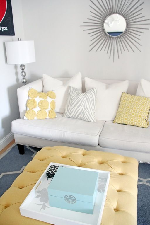 Tufted ottoman in place of a coffee table - this one is from Target. Love everything!