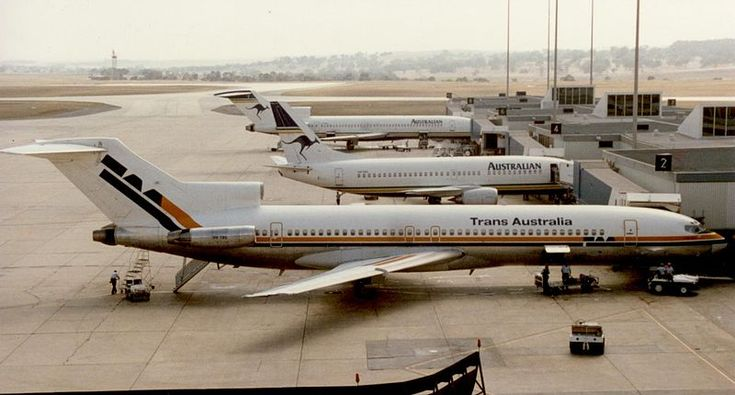 A Trans Australia Airlines Boeing 727-276 alongside some renamed Australian Airlines jets at Tullamarine Airport Melbourne - Australia. The Airline was renamed Australian Airlines in 1986.