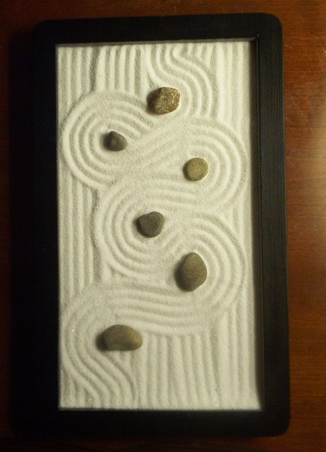 sand zen ... Make a table top zen garden? Put glass over it to keep it from being messy?