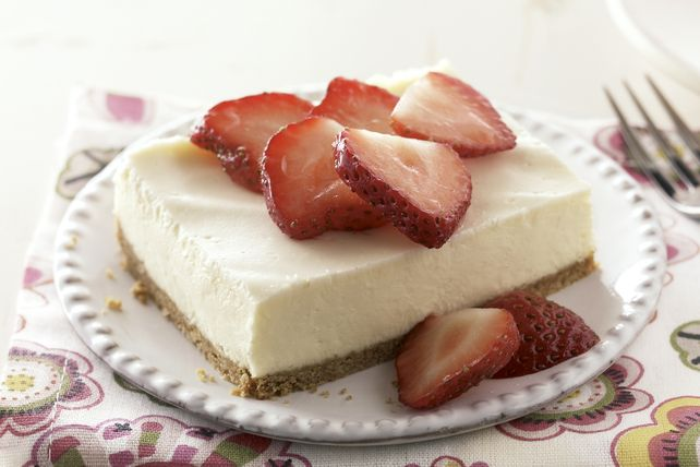 This basic traditional sour cream cheesecake is always a favourite among our readers. Its richness is balanced by a ripe strawberry fruit topping. Now made in a 13x9-inch pan, it's easy and just right for Spring.