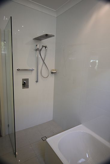Gessi Via Manzoni showers & tapware, shown with Halo tile insert wastes. Bathroom by Lucy J Design