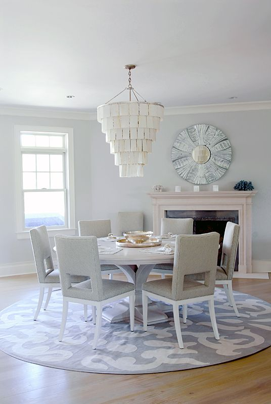 Gray Dining Area With Fireplace And Round Rug Amagansett Home By Mabley Handler Interior Design