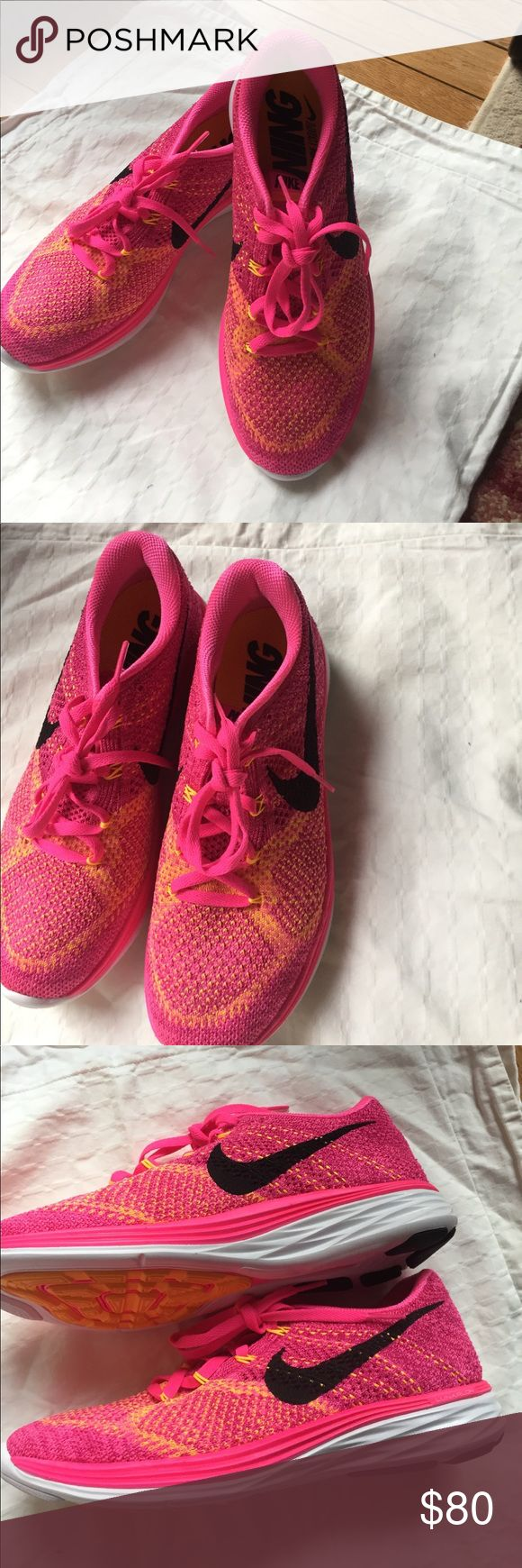 Nike Running Shoes Pink and orange neon running shoes. Lunarlon soles very light. New never worn Nike Shoes Athletic Shoes