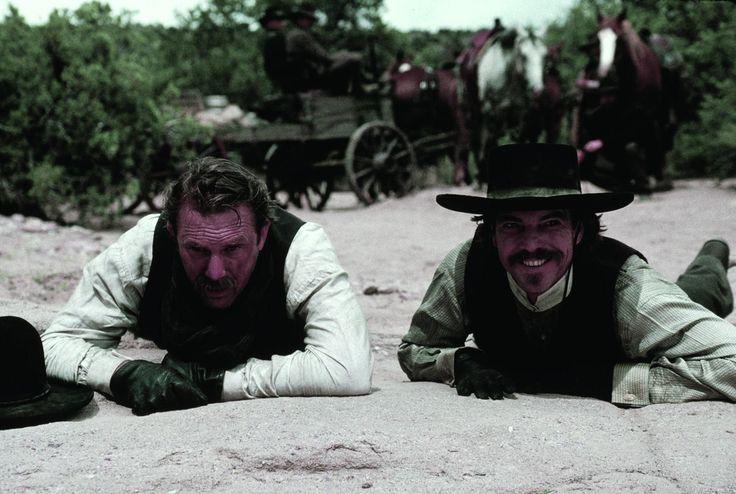 Kevin Costner and Dennis Quaid in Wyatt Earp (1994) http://www.movpins.com/dHQwMTExNzU2/wyatt-earp-(1994)/still-457158656