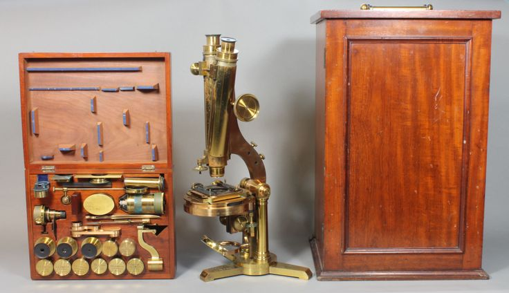 A 19th Century brass binocular microscope by R J Beck contained in a well fitted mahogany case enclosing a cased set of accessories together with a mahogany box containing additional accessories, est £400-600