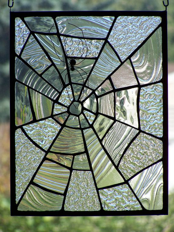 This glass piece is approximately 10 3/8 by 13 3/8. The spiderweb was created using clear textured glass with the copper foil method of