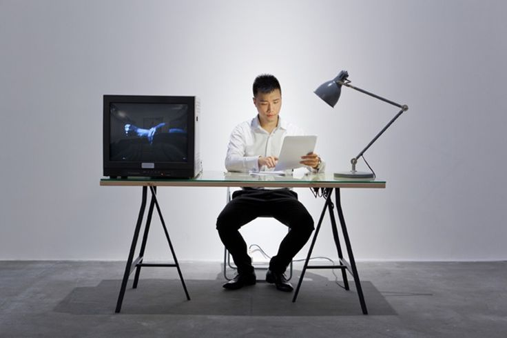 """Yan Xing The History of Reception, 2012 Performance, video installation (VHS cassette, 17"""" monitor, Panasonic AG-6400 portable video cassette recorder, script papers, pen, cigarette butt, labels, table lamp, glass pane, work table, folding chair)"""