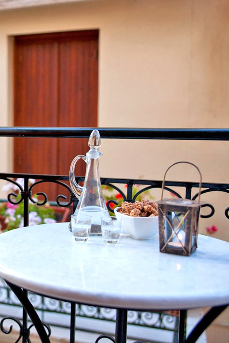 Raki and meze on the lovely balcony at Mili House, the old Venetian 3-storey house in Chania town #crete #travel #TheHotelgr