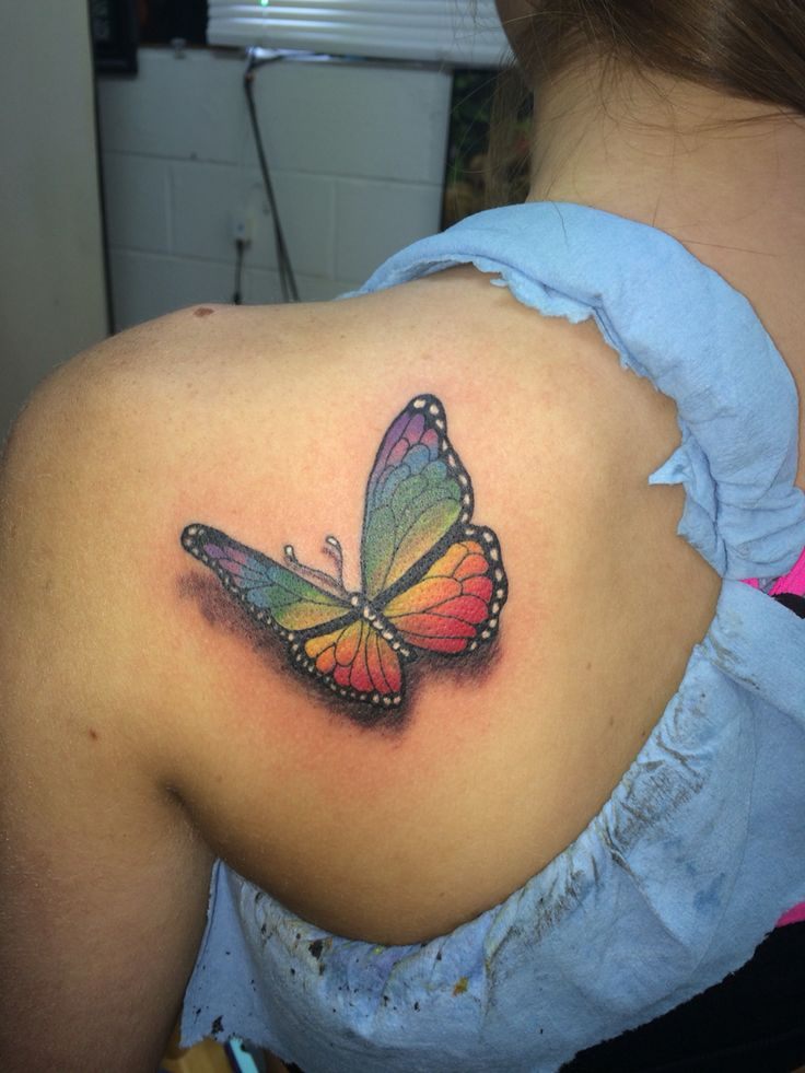 Realistic Rainbow Colored Butterfly Tattoo Done By Ricky Garza In Victoria Tx Got Ink Xtreme Ink T Rainbow Tattoos Butterfly Tattoo Butterfly Tattoo Designs