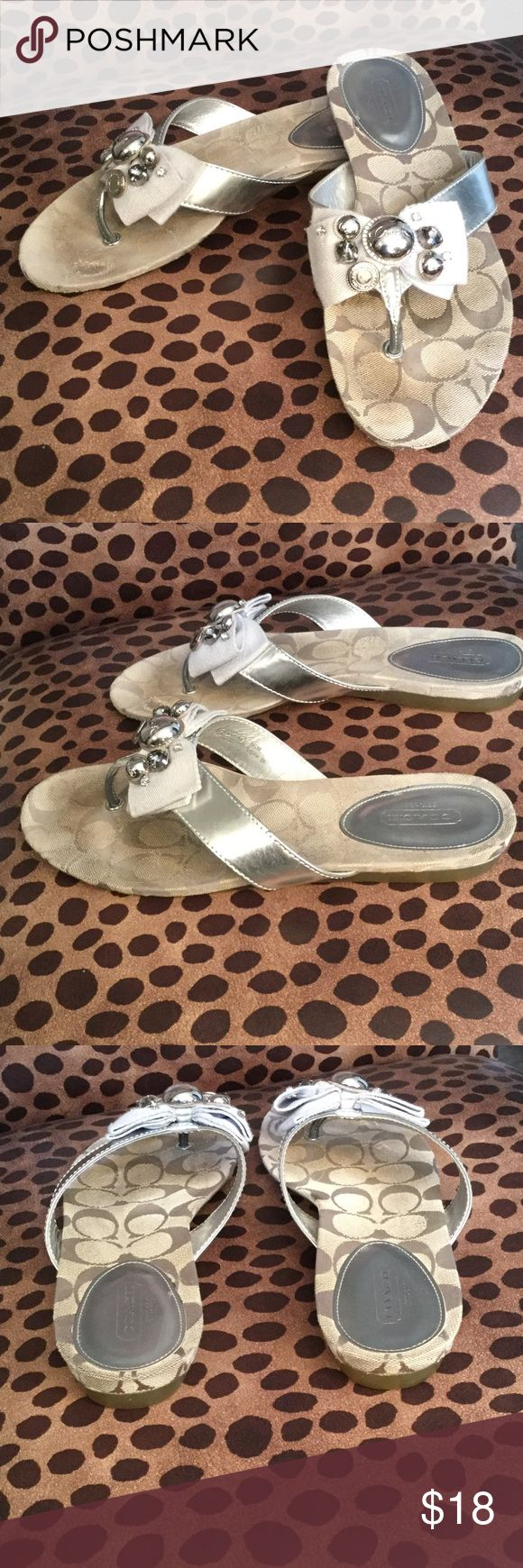 """COACH """"Sylvia"""" Flip Flop Silver Sandal COACH """"Sylvia"""" Silver/Gray Metallic Flip Flop Sandal size 8. These are preowned showing signs of wear. I took pics of all angles to show exactly what you're receiving. A tailored bow with sparkling jewels and shiny rivets updates a classic thong sandal, crafted in glossy patent leather and signature fabric with a barely-there wedge and a non-skid rubber sole. Coach Shoes Sandals"""