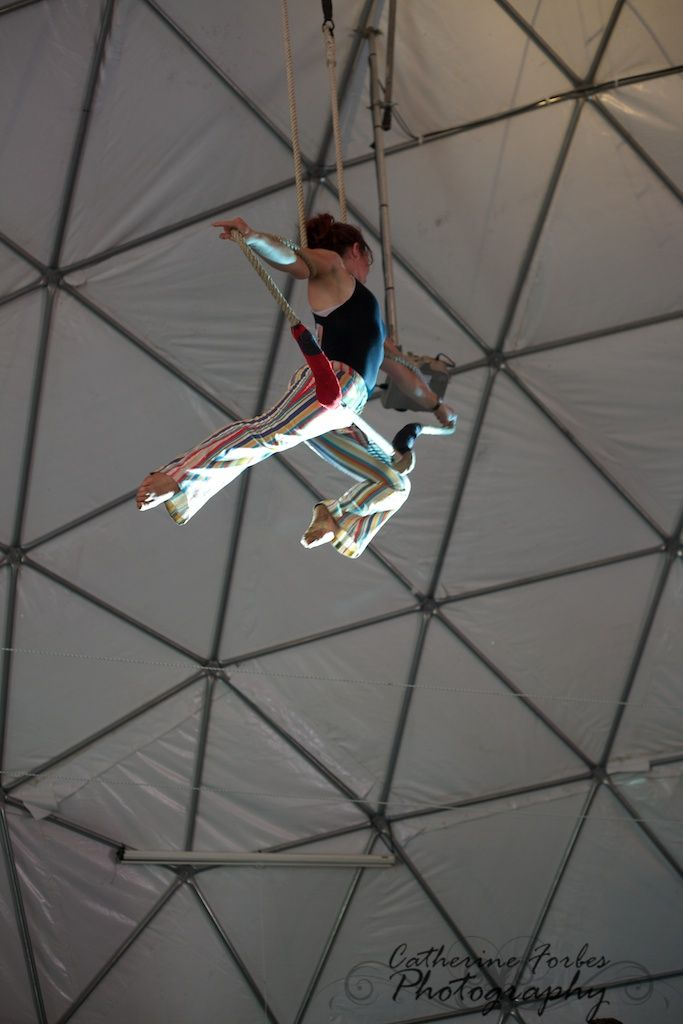 Kara on trapeze at Peats Ridge Festival in the dome we once part-owned