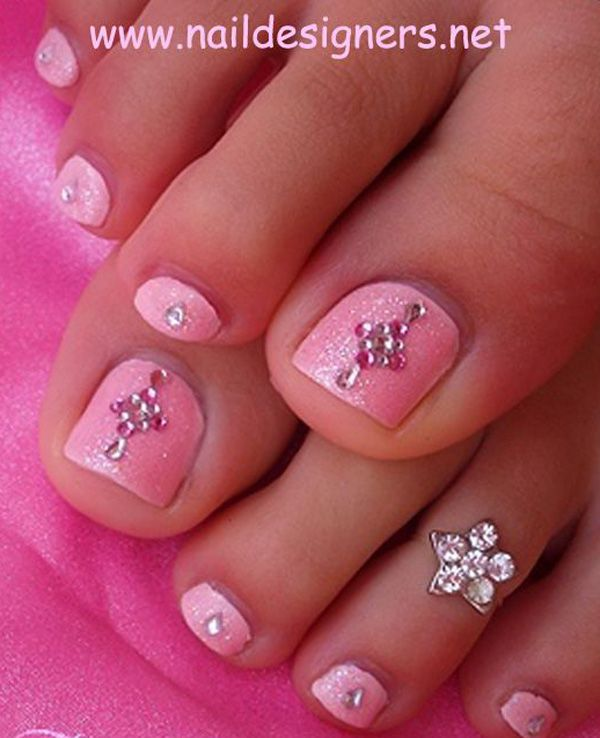 An elegant looking pink themed toenail art design. Use a frosted pink polish as base and add tiny pink and silver beads on top. The toenail art looks very neat, clean and classy.