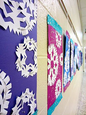 Kirigami Snowflake banners... Such a neat way to display the traditional paper snowflakes. I've also heard cupcake liners & coffee filters work great as premade circles.