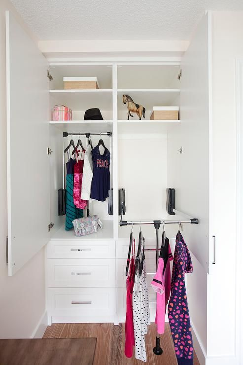 Simple Closet With Pull Down Clothes Rail By Stor X Organizing System.