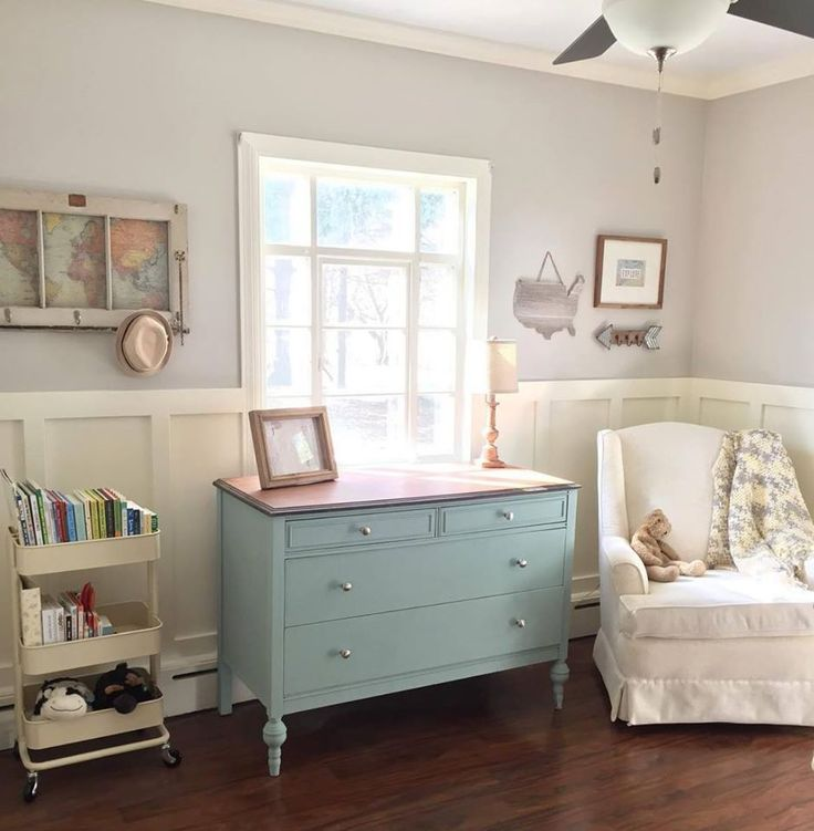 This very funky travel-inspired nursery by Ashley Kaisk includes a simple, classic chest of drawers in Duck Egg Blue.