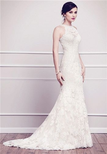 Jeweled neckline fit and flare gown layered with corded Alencon lace provide subtle contrast with an elegant back piece finished with covered buttons. Zipper back.