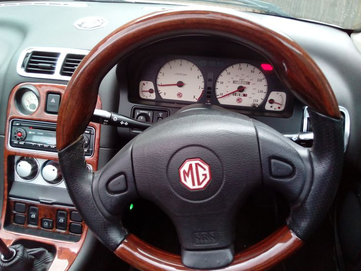 Wood and leather trimmed steering wheel with wood, brushed aluminium and chrome dash and centre console
