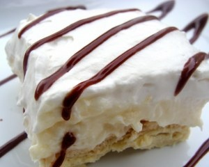 """Change the flavor of the pudding for more delicious variations. Years ago, we called them """"Lush Cakes"""". Lemon Lush, Chocolate Lush, Butterscotch Lush. You get the idea. But it is a wonderful, easy, delicious dessert that never fails to impress."""