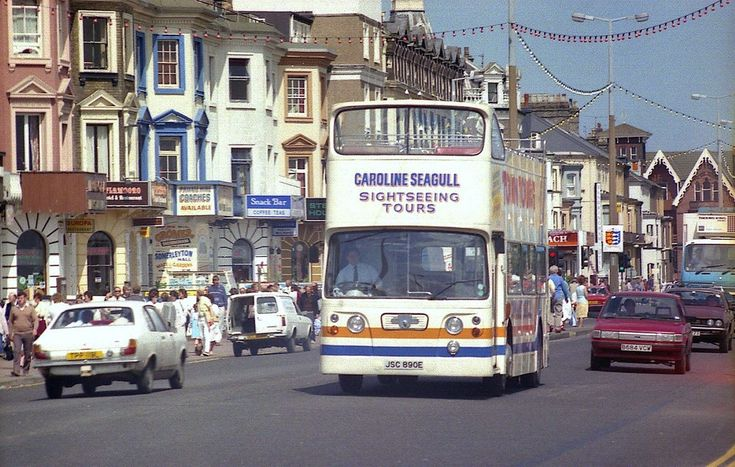 https://flic.kr/p/6dP8vD   Caroline Seagull, Open Top Atlantean.   On one of those rare days when everything in your little world felt right, the sun was shining, and there was a town full of interesting buses and coaches at which to point your camera, Caroline Seagull's Ex Edinburgh Open Top Atlantean bowls along the Great Yarmouth sea front. JSC 890E represented a slightly earlier delivery to the Scottish capital's fleet, compared to the bus in my previous posting. Cobham Hire Services t/a…