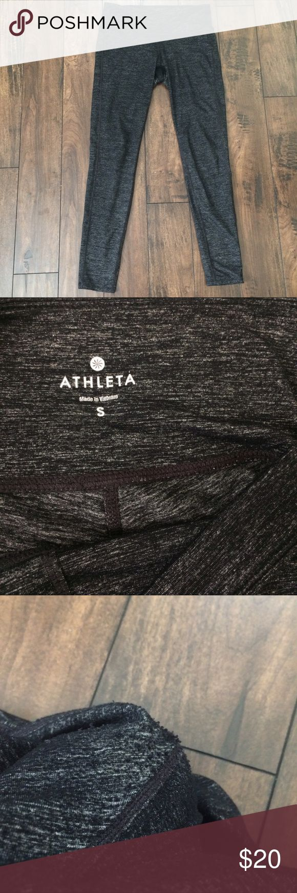 """Athleta Grey Workout Pants Dark grey fitted leggings from Athleta in good condition and have been well worn. Photo #3 shows the piling on the outside of the crotch area and #4 shows that the fabric has worn out. They are extremely soft and comfortable, however the care tag has been cut out so I'm not certain on the fabric or style. Approximate measurements of the waist laying flat are top band 14"""", hip 15"""", and length is 34"""". Athleta Pants Leggings"""