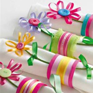 Use your oddments of ribbons and leftover buttons to make these fun napkin holders. Tutorial.