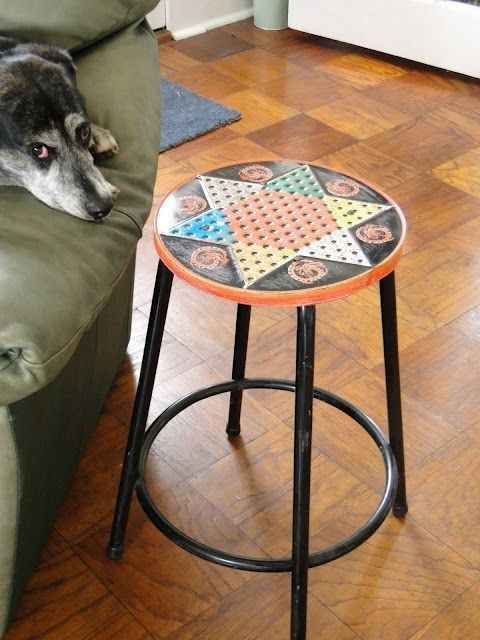 Turn a Chinese checkers board into a bar stool.