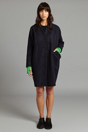 Lana Coat in Black - This coat is made from thick, warm wool and features a 'pod-like' silhouette that finishes just above the knee. It has a deep V neckline and fastens with four subtly decorative buttons.