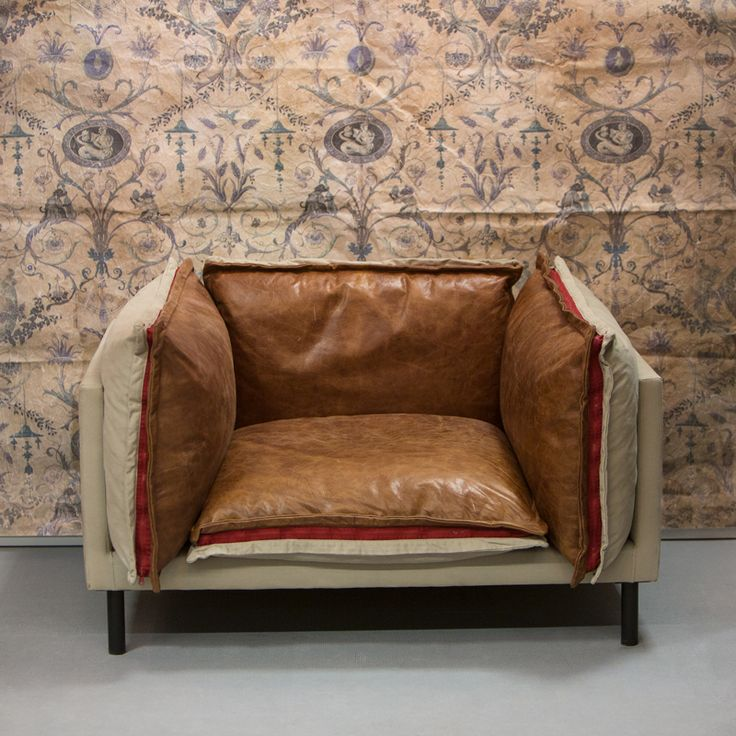 Mimezis armchair. Wallpaper. Exclusive two-sided furniture - one side edged with a soft Italian leather, the other with soft velvet. Price: 7 400 PLN