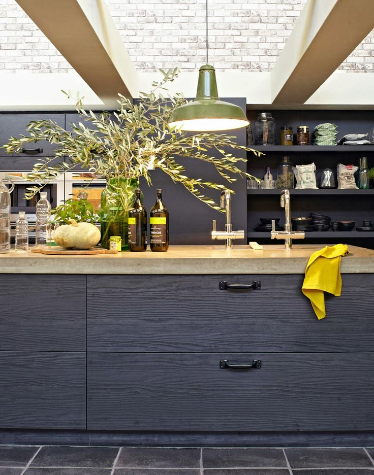 Industrial black kitchen with natural stone counters:
