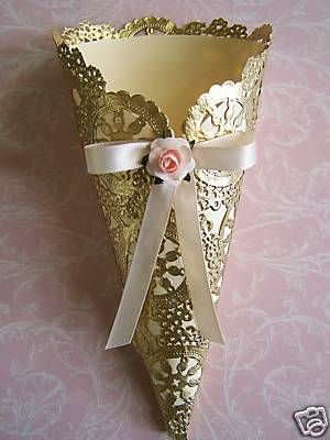 Gorgeous confetti cone in cream and gold with a cute bow and rose