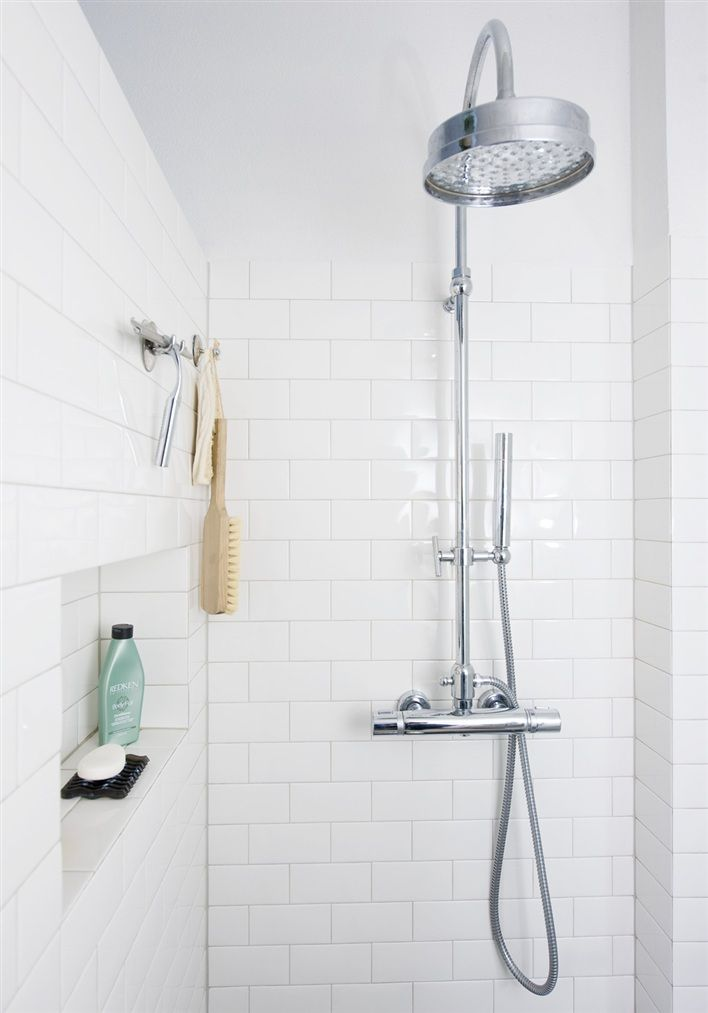 White tile shower + great shower head